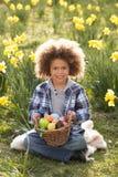 男孩黄水仙复活节彩蛋领域搜索 库存照片