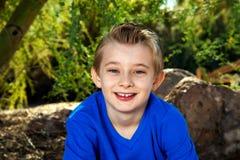 年轻男孩画象蓝色的 图库摄影