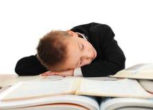 男小学生睡觉 免版税图库摄影