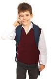 男小学生联系由电话移动电话 图库摄影