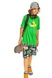 男小学生青少年与滑板 库存照片