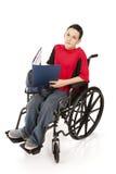 男小学生青少年的轮椅 库存照片