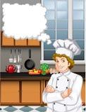 男性厨师在厨房里 免版税库存图片