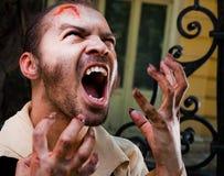男性吸血鬼受伤 免版税库存图片