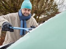 男性和冰刮板 免版税库存照片