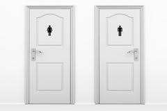 男性和女性性别的洗手间门 免版税库存图片