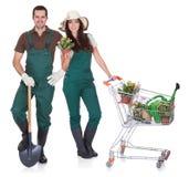 男性和女性花匠纵向  免版税库存图片