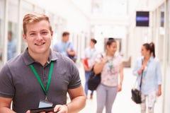 男性大学生画象在走廊 库存图片