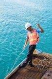 男性工作者在轮渡在海码头的停车处过程中 免版税库存图片