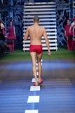 男性式样走在阶段 库存照片