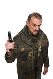 男性恐怖分子军事夹克 枪在他的手上 图库摄影