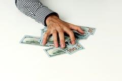 男性手举行美元 免版税库存照片