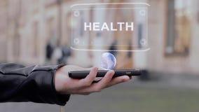 男性手在智能手机概念性HUD全息图健康显示