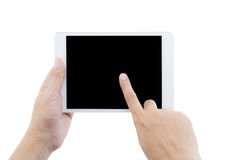 男性手拿着片剂计算机的和手指接触屏幕 库存照片
