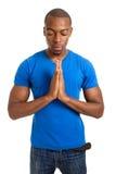 男性祈祷的学员 库存图片