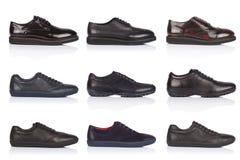 男性穿上鞋子在白色背景的汇集,与光滑的表面上的一个阴影 正面图 9个片断 库存照片