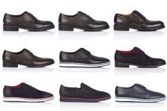 男性穿上鞋子在白色背景的汇集,与光滑的表面上的一个阴影 正面图 9个片断 免版税图库摄影