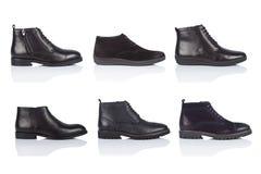 男性穿上鞋子在白色背景的汇集,与光滑的表面上的一个阴影 正面图 6个片断 免版税图库摄影