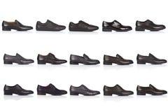 男性穿上鞋子在白色背景的汇集,与光滑的表面上的一个阴影 正面图 15个片断 免版税库存照片