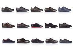 男性穿上鞋子在白色背景的汇集,与光滑的表面上的一个阴影 正面图 15个片断 图库摄影