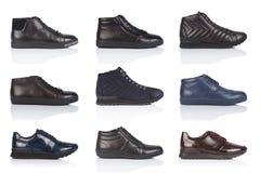 男性穿上鞋子在白色背景的汇集,与光滑的表面上的一个阴影 正面图 9个片断 免版税库存照片