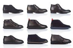男性穿上鞋子在白色背景的汇集,与光滑的表面上的一个阴影 正面图 9个片断 免版税库存图片