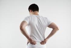 男性腰部痛苦 库存图片