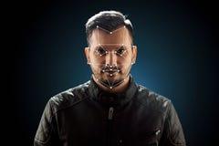 男性面孔,生物统计的证明面貌识别 面貌识别技术在多角形栅格的被修建  免版税库存图片