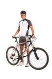 年轻男性骑自行车者 库存照片