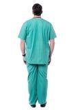 男性医生后面姿势  免版税库存图片
