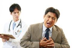 男性医生和男性商人 图库摄影