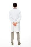 男性医生用在他的后的手  免版税库存照片