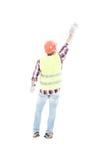 男性建设者poiting的手指背面图  免版税库存照片