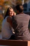 男朋友产生看起来爱恋的妇女 免版税图库摄影