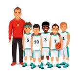 男生与他们的教练的蓝球队 免版税库存照片