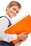 男生拿着一本书 库存图片