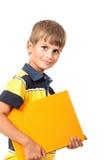 男生拿着一本书 库存照片