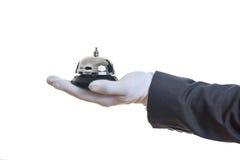 男管家服务响铃在一只手套的手上 免版税库存照片