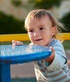 男婴儿童游戏在操场区域 免版税图库摄影