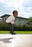 男婴庭院年轻人 免版税图库摄影