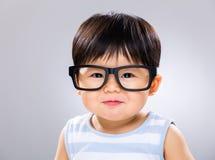 男婴穿戴玻璃 库存照片