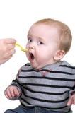 男婴进餐时间 免版税库存图片