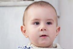 男婴逗人喜爱的面孔 库存图片