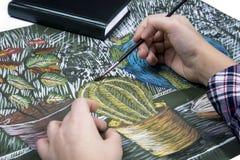 画与油漆静物画的一把刷子的过程 库存图片