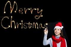 画圣诞快乐的妇女由闪烁发光物 库存照片