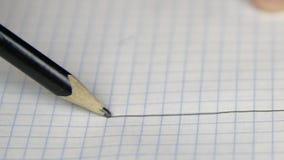 画在习字簿页的一条线与铅笔 影视素材