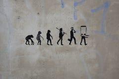 画在人的演变的墙壁上 图库摄影