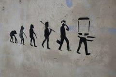 画在人的演变的墙壁上 库存照片