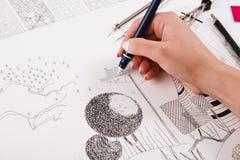画建筑项目特写镜头的建筑师 免版税库存图片