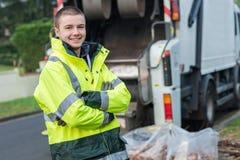 画象年轻微笑的垃圾收集车 免版税图库摄影